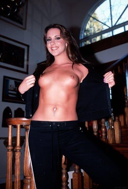 Amsterdam Escort Barbara standing with bare breasts