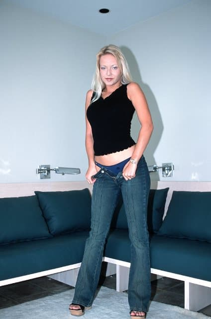 Cynthia standing in blue jeans and black top.